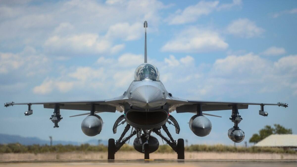 An F-16 fighter jet taxis toward the hangars at Holloman Air Force Base, N.M.