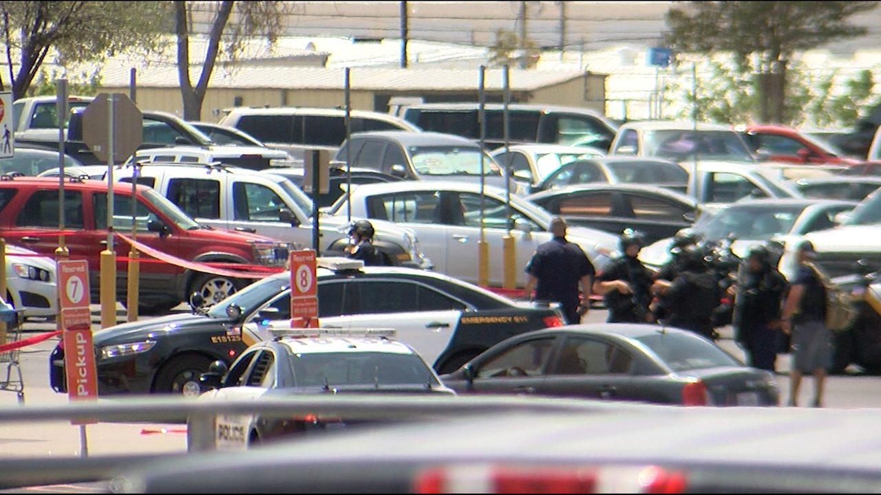 Police gather in the Cielo Vista Walmart parking lot following the Aug. 3 mass shooting.