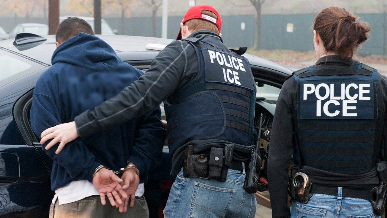 ICE agents make an immigration arrest.