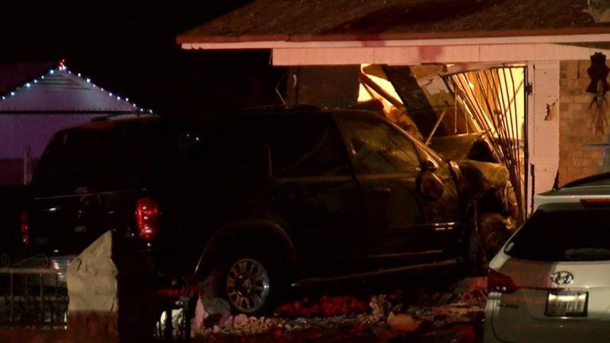 suv crashes into house