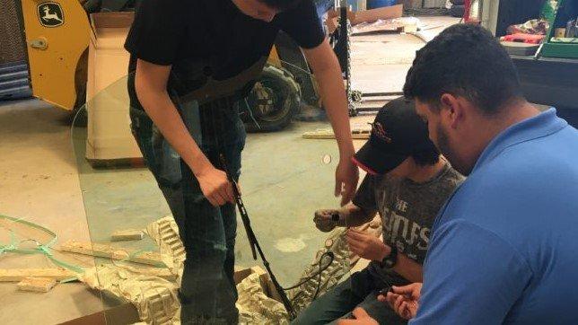 students repair farm equipment