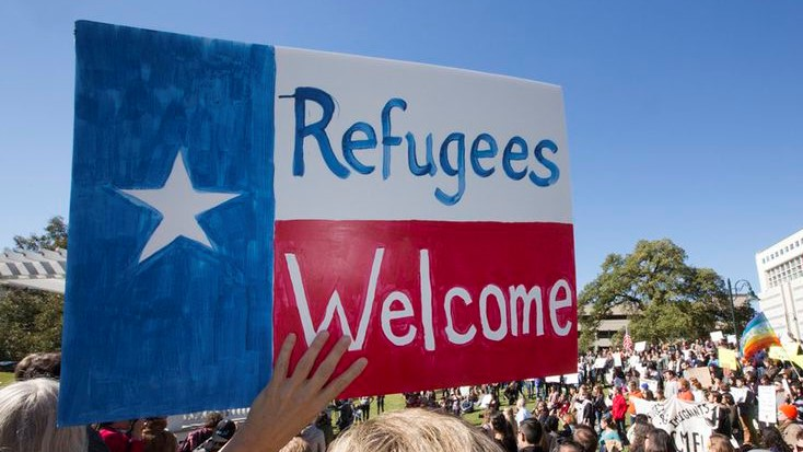 A group demonstrates in Austin in support of Texas accepting refugees in this file photo.