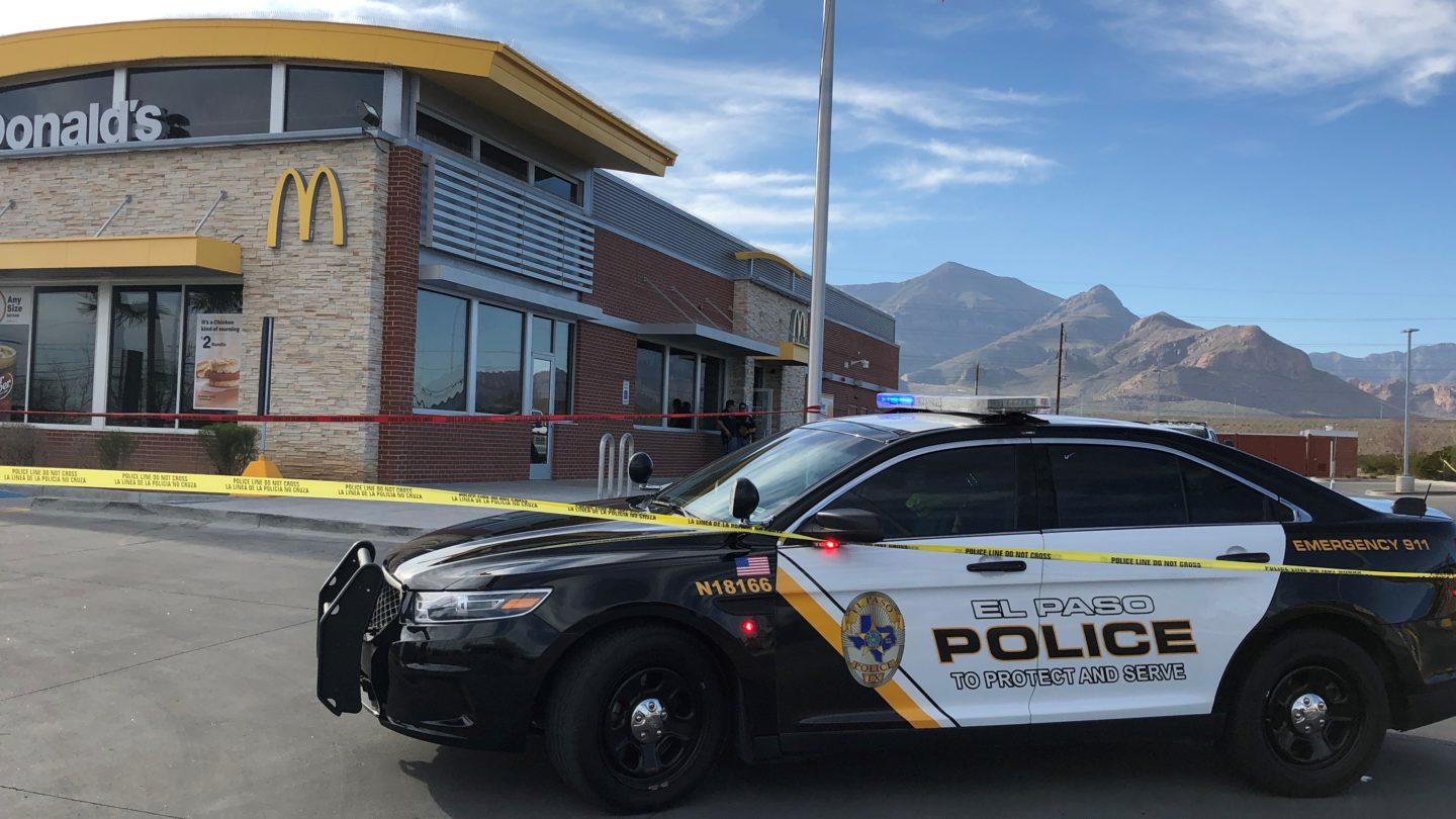 Police block off the crime scene at a McDonalds where a little girl was stabbed in El Paso.