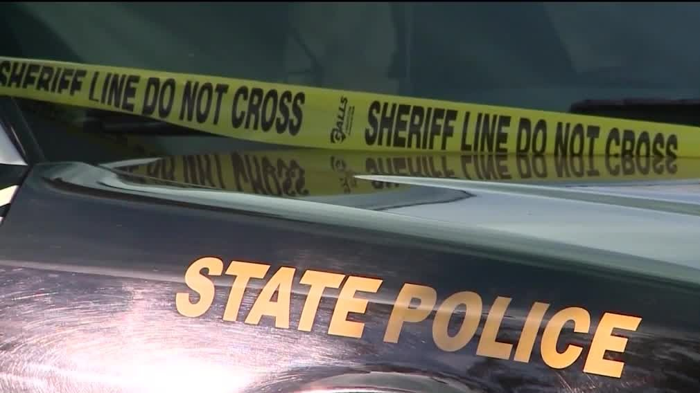 A New Mexico State Police car and police tape are seen in this file photo.
