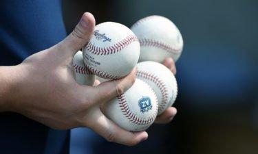 Umpire holding baseballs
