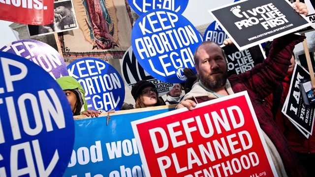 Abortion protesters, both pro-life and pro-choice, hold counter demonstrations in this file photo.
