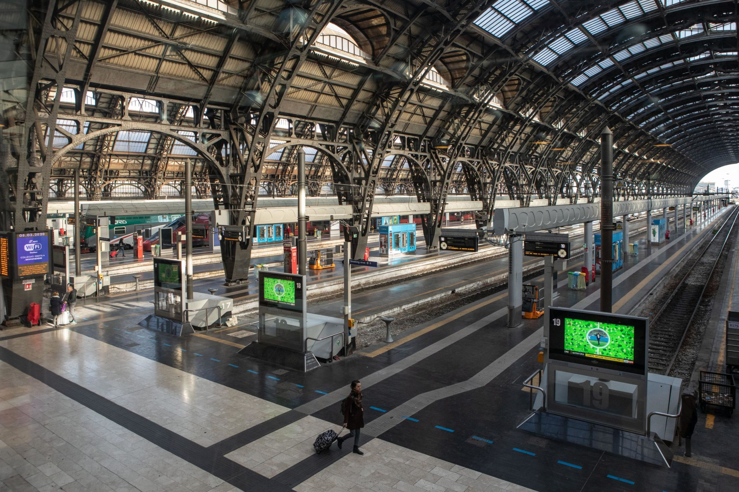 A woman walks in the almost deserted Central Station in Italy after the lockdown was imposed.