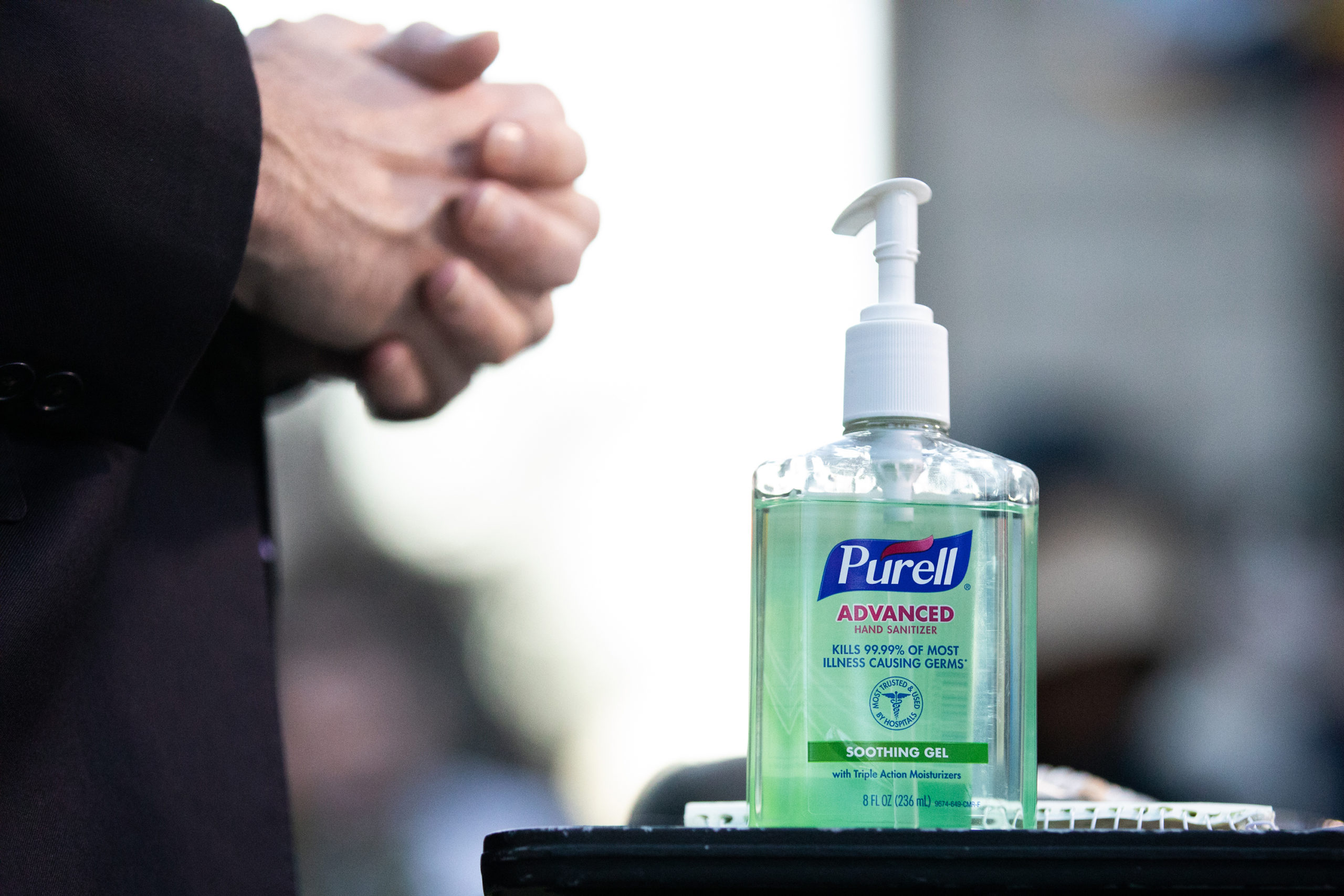 A bottle of hand-sanitizer is seen.