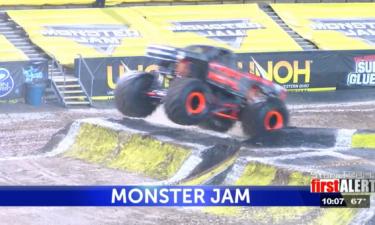 Monster trucks jump over ramps at Monster Jam