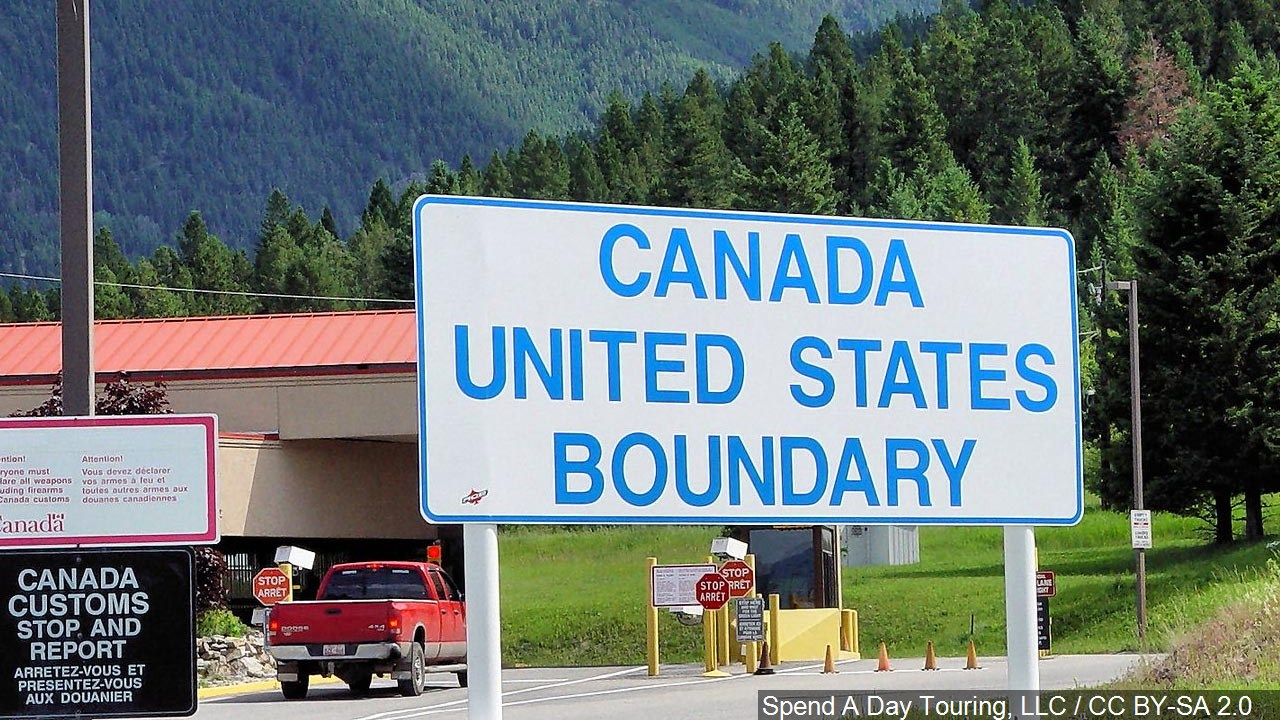 A sign showing the U.S./Canada border.