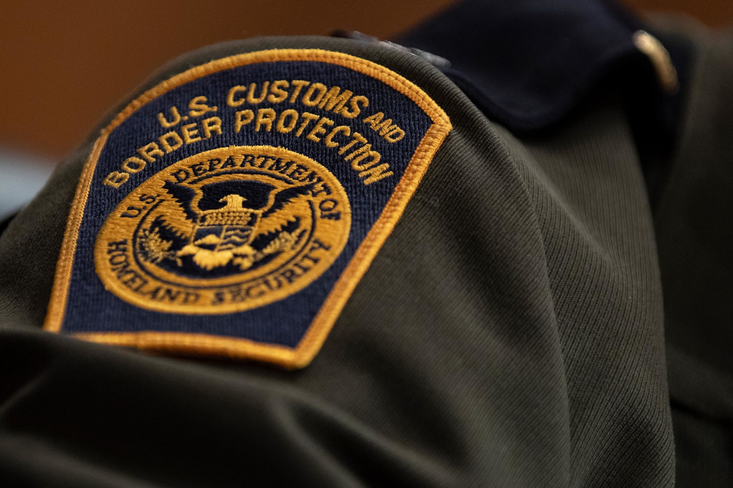 A U.S. Customs and Border Protection patch on the uniform of an agent.