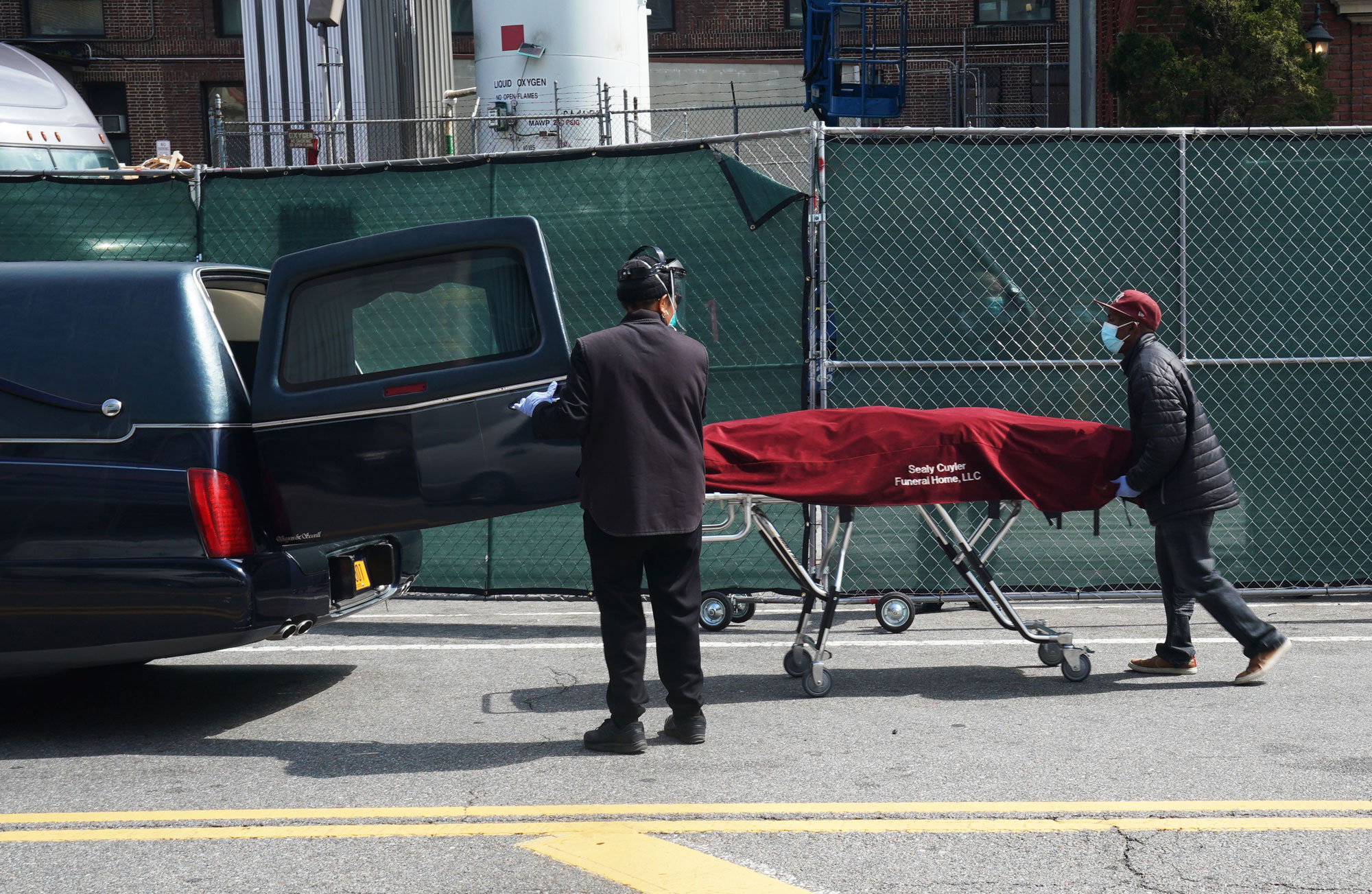 funeral workers hearse body
