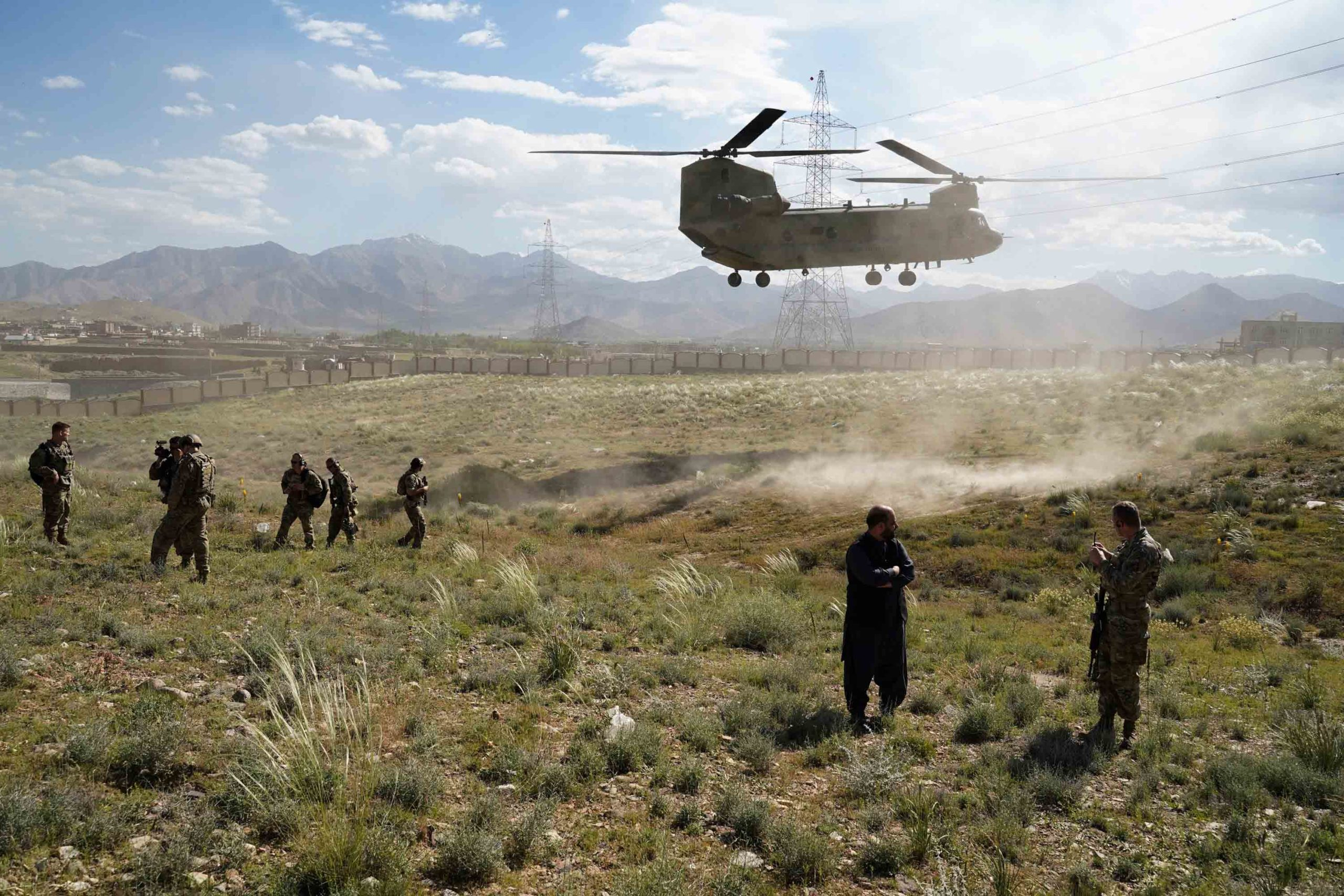 A U.S. military Chinook helicopter lands on a field in Maidan Shar, Afghanistan.