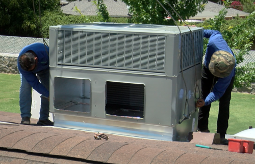 Total Air working on a roof during triple-digit temps