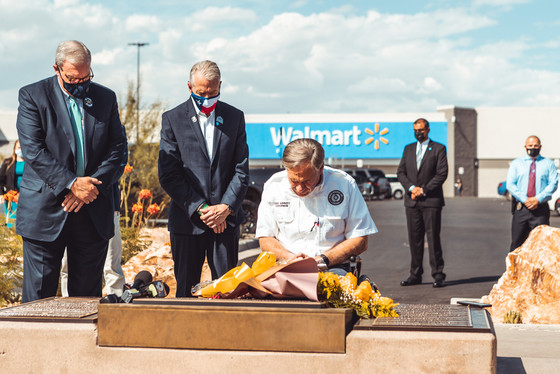Texas Gov. Greg Abbott along with then- El Paso Mayor Dee Margo and County Judge Ricardo Samaniego have a solemn moment at the Walmart memorial.