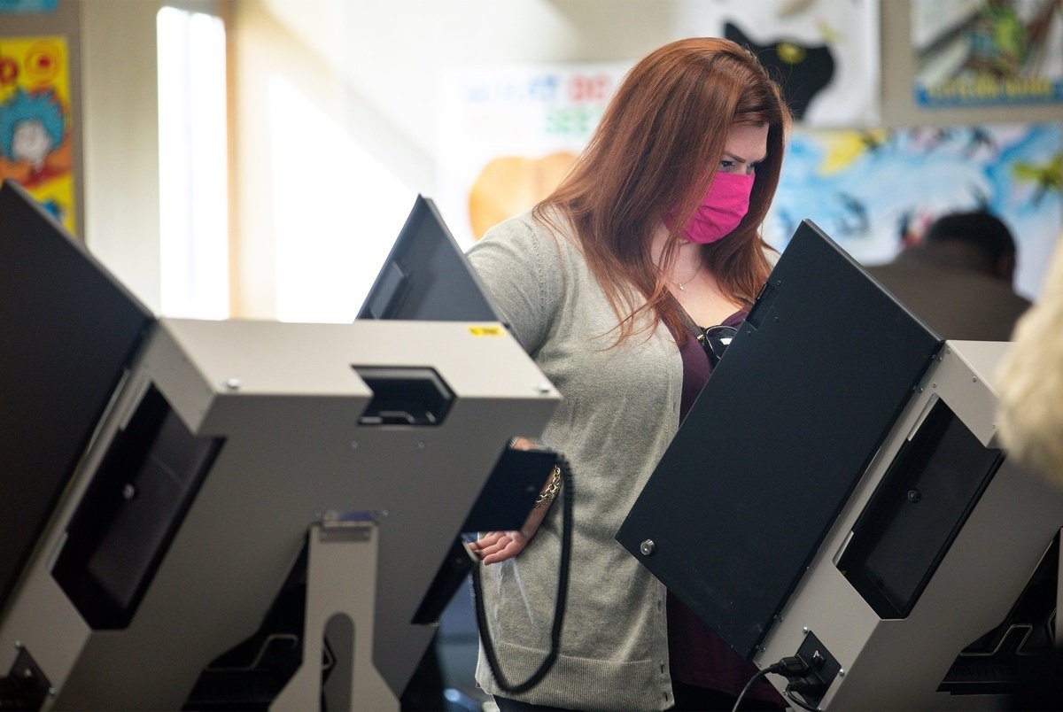 A Texas voter casts her ballot at a polling place in Dallas.