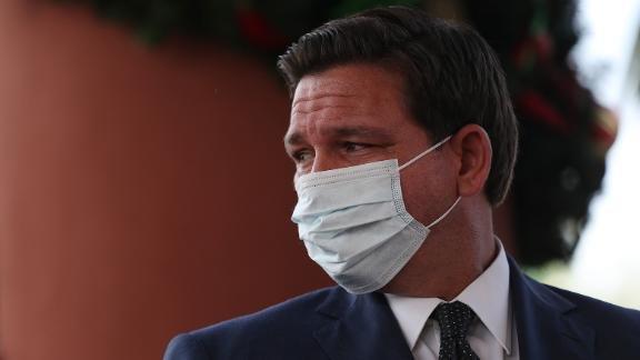 Florida Gov. Ron DeSantis wearing a mask prior to his mandate banning them.