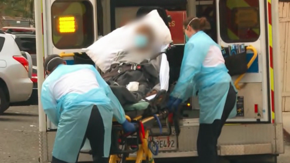 Paramedics handle a coronavirus patient in Los Angeles, California.