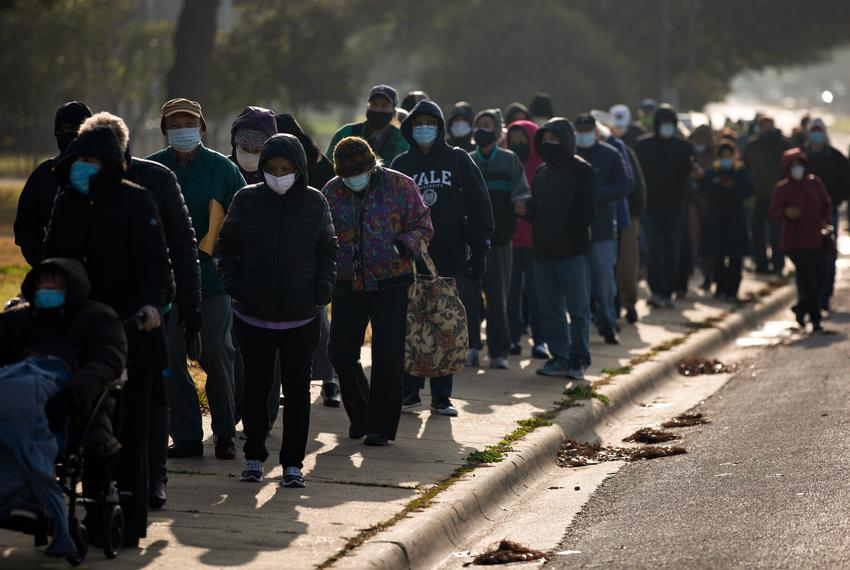 Residents stand in line at a vaccination site at Fair Park in Dallas.
