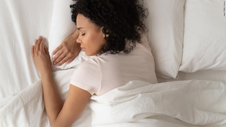 A woman sleeps on a bed in this file photo.