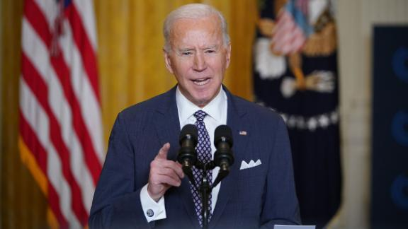 President Biden gestures while speaking at the White House.