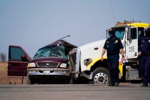 Authorities examine the crash scene in SoCal that killed 13 migrants.