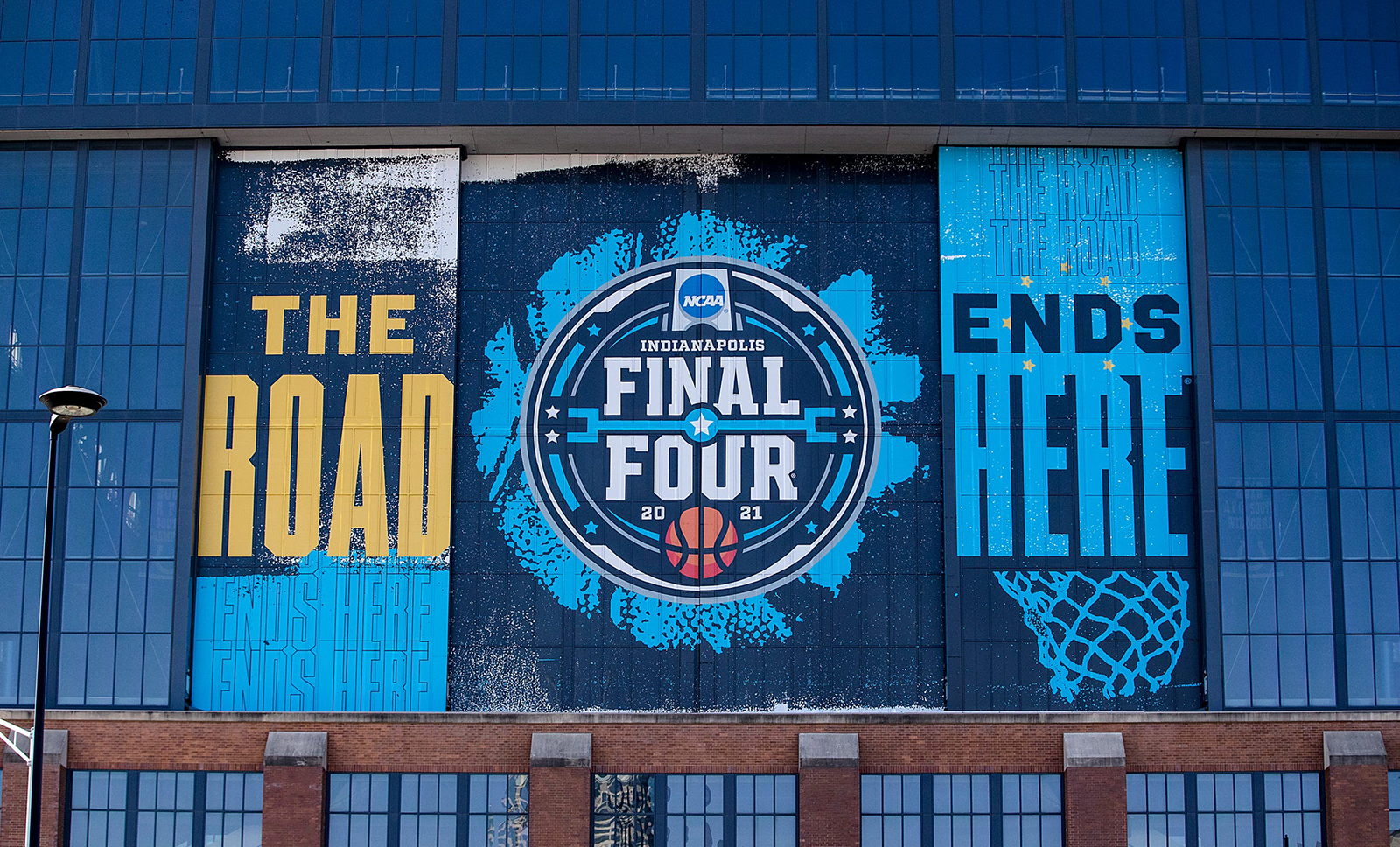 Signs on the side of Lucas Oil Stadium promotes the NCAA Final Four in Indianapolis.