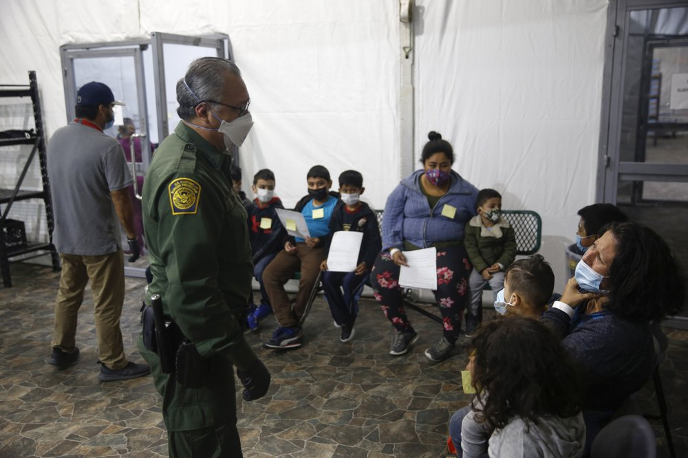 Migrants are processed at the intake area of the U.S. Customs and Border Protection facility, the main detention center for unaccompanied children in the Rio Grande Valley, in Donna, Texas.