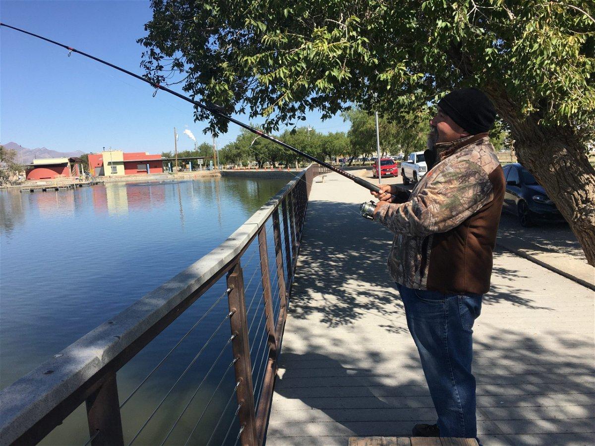A fisherman at the lake at Ascarate Park.