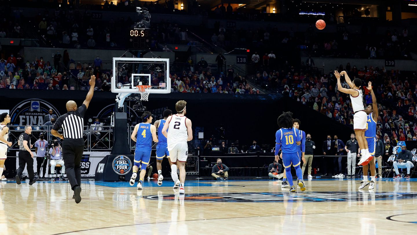 Jalen Suggs #1 of the Gonzaga Bulldogs shoots a game-winning three point basket in overtime to defeat the UCLA Bruins 93-90 during the 2021 NCAA Final Four semifinal.