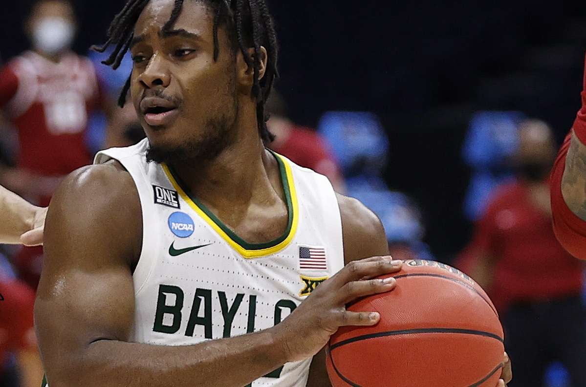 Davion Mitchell #45 of the Baylor Bears cuts away from the defensive pressure in the NCAA Men's Basketball Tournament in Indianapolis, Indiana.