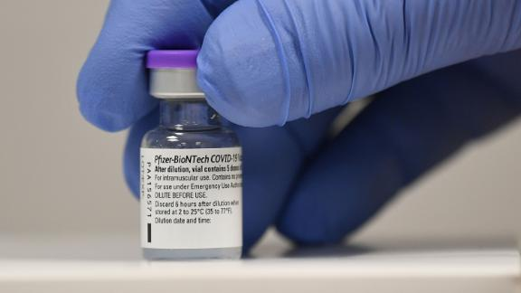 A healthcare worker holds a vial of the Pfizer coronavirus vaccine.