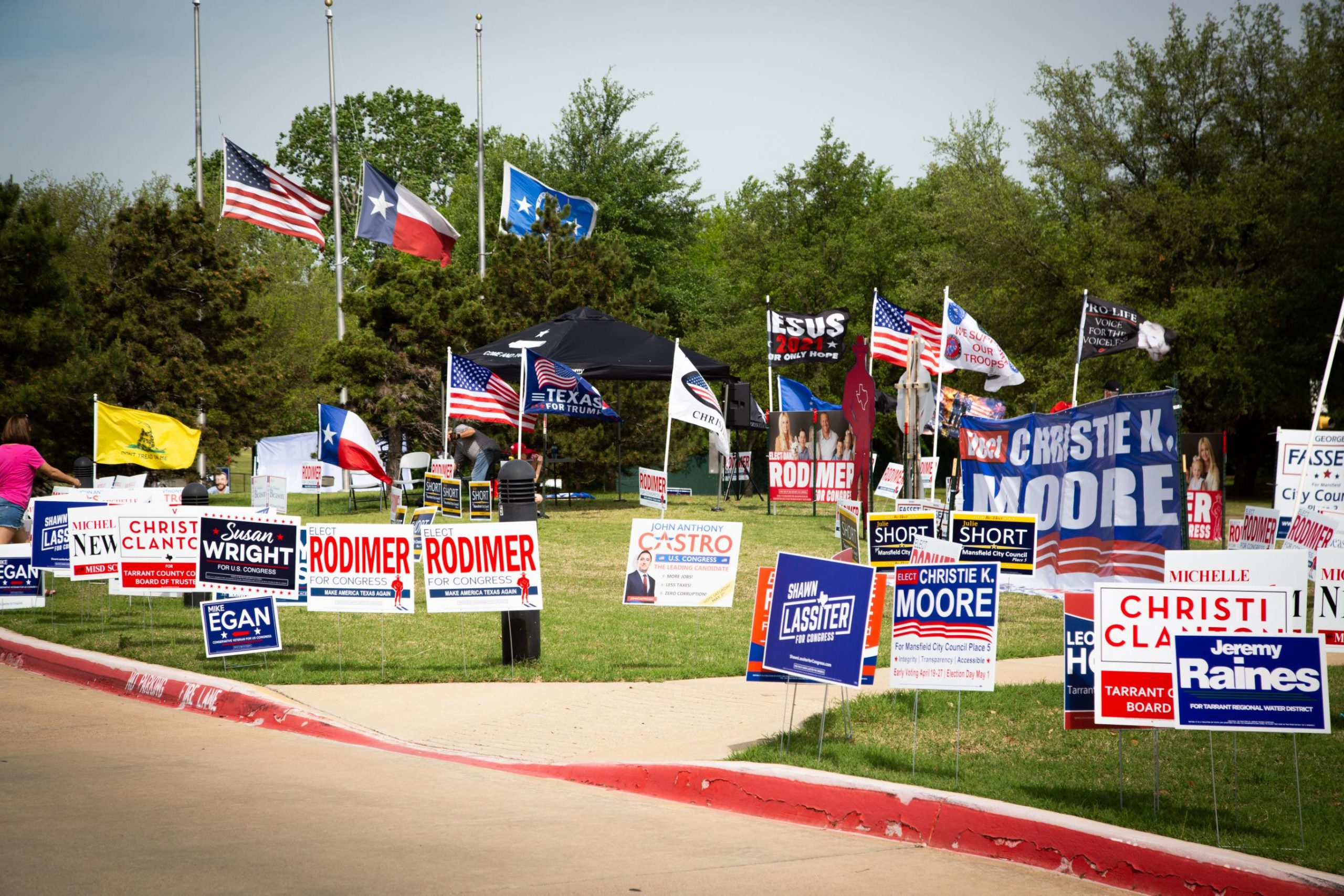 Susan Wright's sign sits amidst a flurry of candidate signs for Texas' sixth district congressional race.