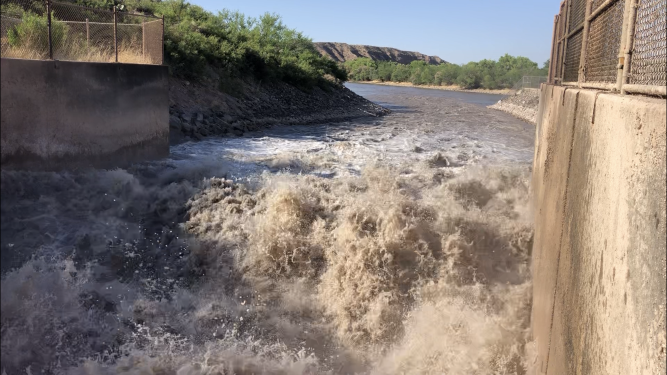 The Elephant Butte Irrigation District releases water into the Rio Grande.
