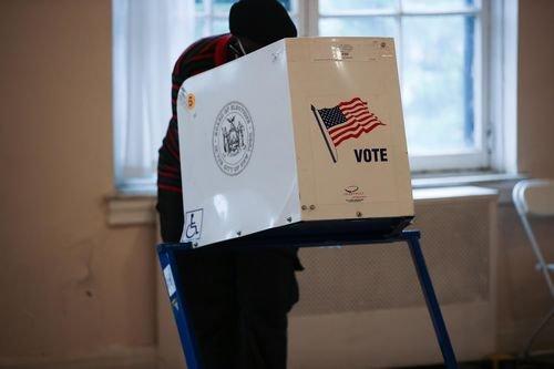 A voter casts an election ballot.