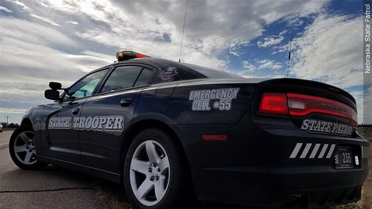 A Nebraska state trooper's patrol car sits along a highway.