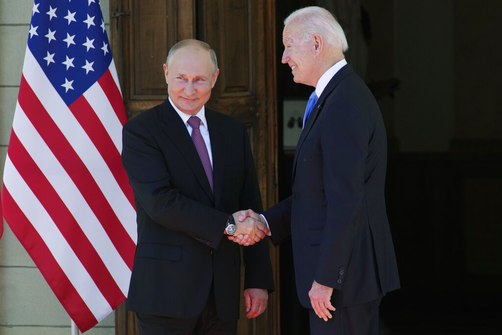 Russian President Vladimir Putin, left, and U.S President Joe Biden shake hands during their meeting at the 'Villa la Grange' in Geneva, Switzerland.