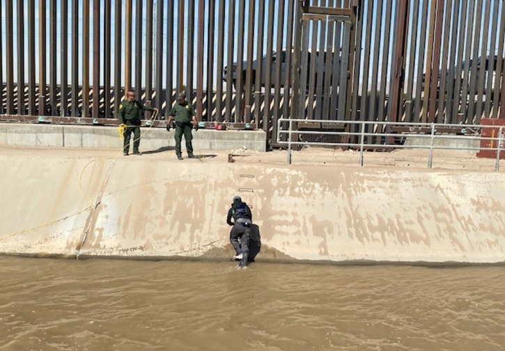Border Patrol agents conduct a water rescue in El Paso's American Canal.