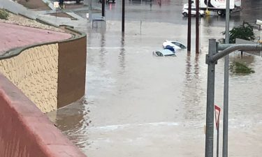 El Paso roads overwhelmed with flood water and cars submerged.