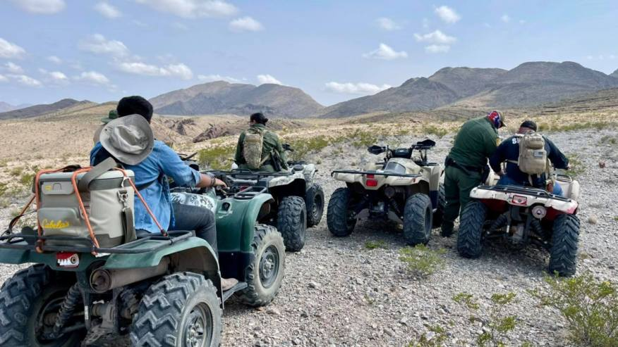 Texas Rescue Patrol, sheriff's deputies and border agents use ATVs to recover a body in the Hudspeth County desert.