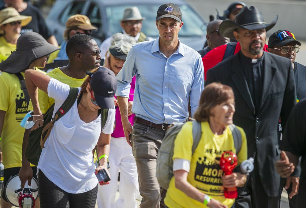 Former Democratic congressman Beto O'Rourke walks along the service road of Interstate Highway 35 to participate in a Selma-style march for democracy.