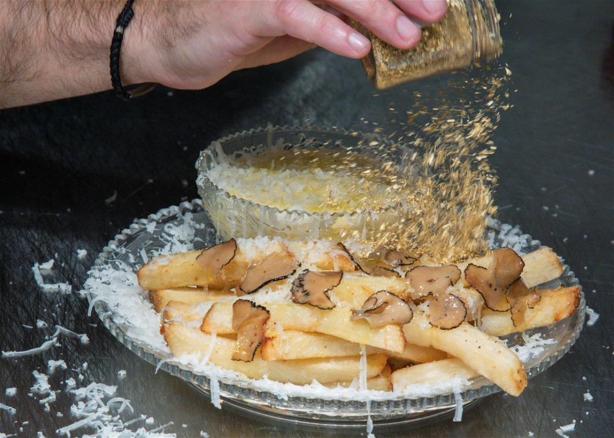 <i>Eduardo Munoz/Reuters</i><br/>Chef Frederick Schoen-Kiewert applies 23-carat edible gold dust on top. as he prepares The Creme de la Creme Pommes Frites