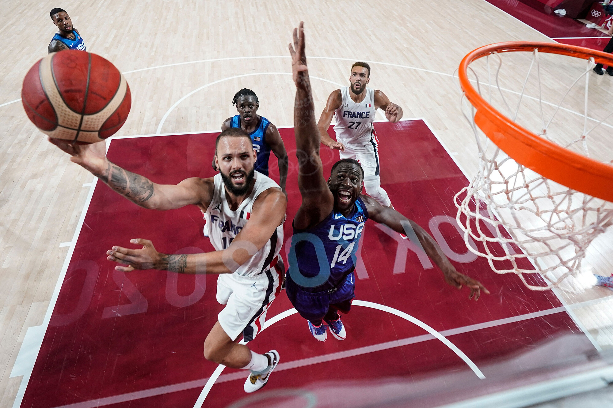 <i>Eric Gay/AFP/Getty Images</i><br/>France's Evan Fournier goes for the basket past USA's Draymond Green at the Saitama Super Arena in Saitama