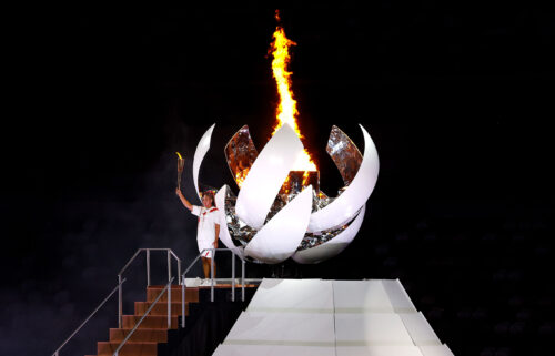 Naomi Osaka of Team Japan lights the Olympic cauldron with the Olympic torch during the opening ceremony of the Tokyo 2020 Olympic Games on July 23.