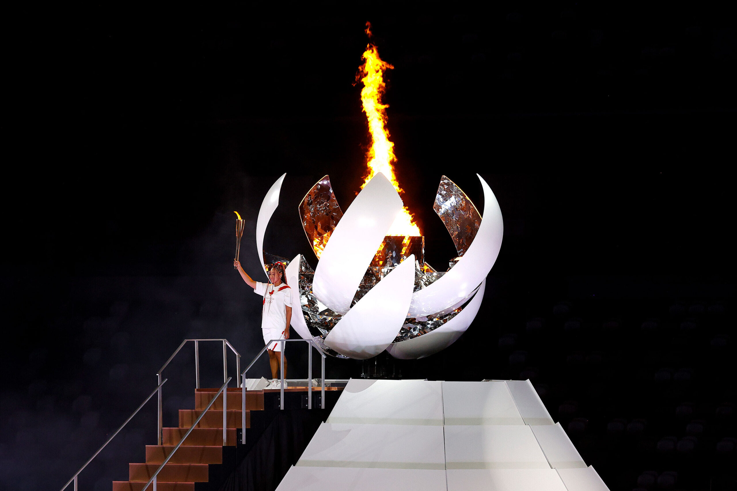 <i>Maddie Meyer/Getty Images</i><br/>Naomi Osaka gestures after lighting the Olympic cauldron during the opening ceremony at the Olympic Stadium.