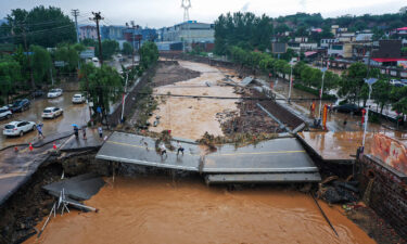A damaged bridge following heavy rains which caused severe flooding in Gongyi in China's central Henan province on July 21.