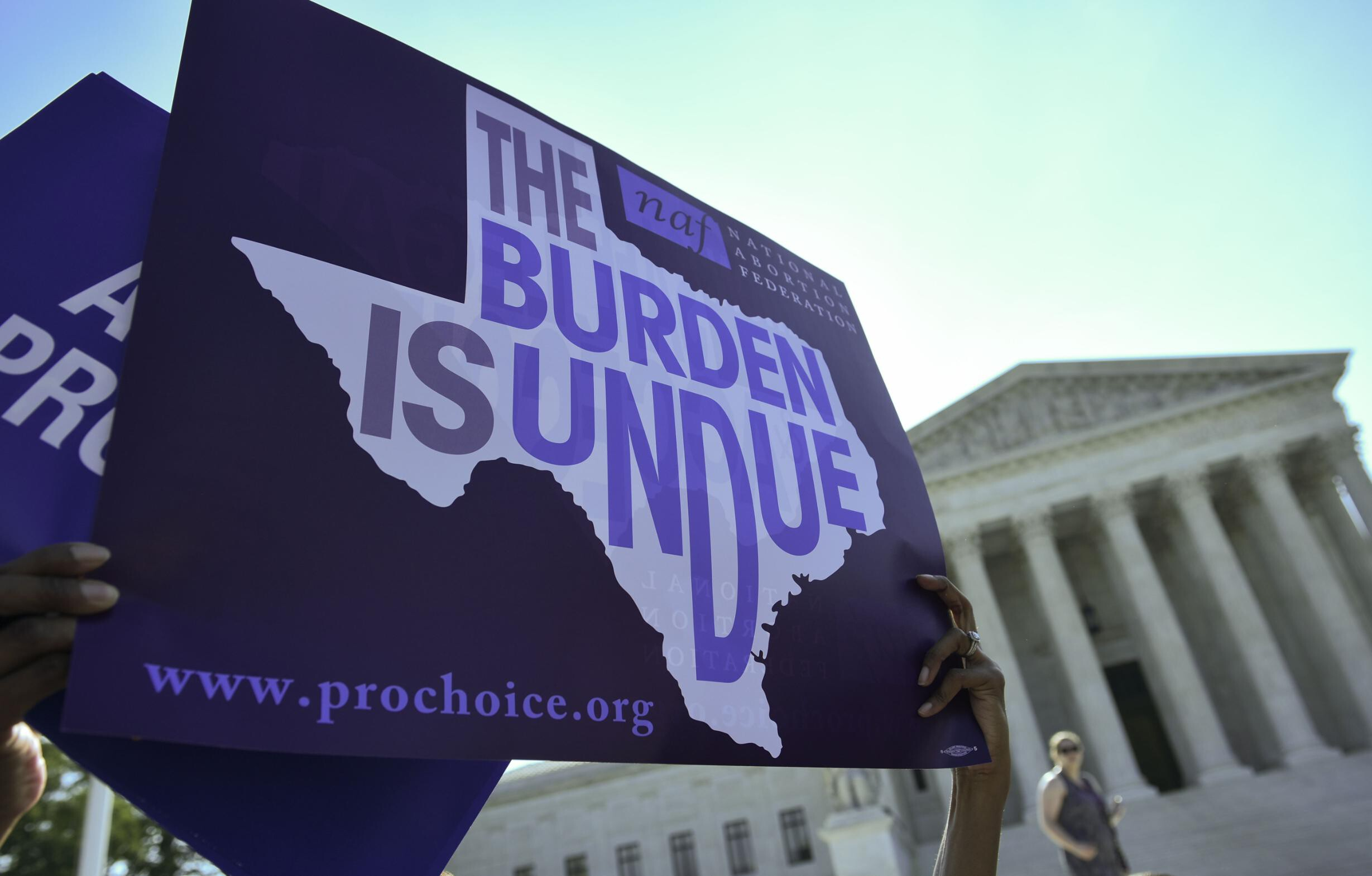 <i>MANDEL NGAN/AFP/AFP/Getty Images</i><br/>A group of abortion rights organizations and providers protest a Texas law outside the U.S. Supreme Court.