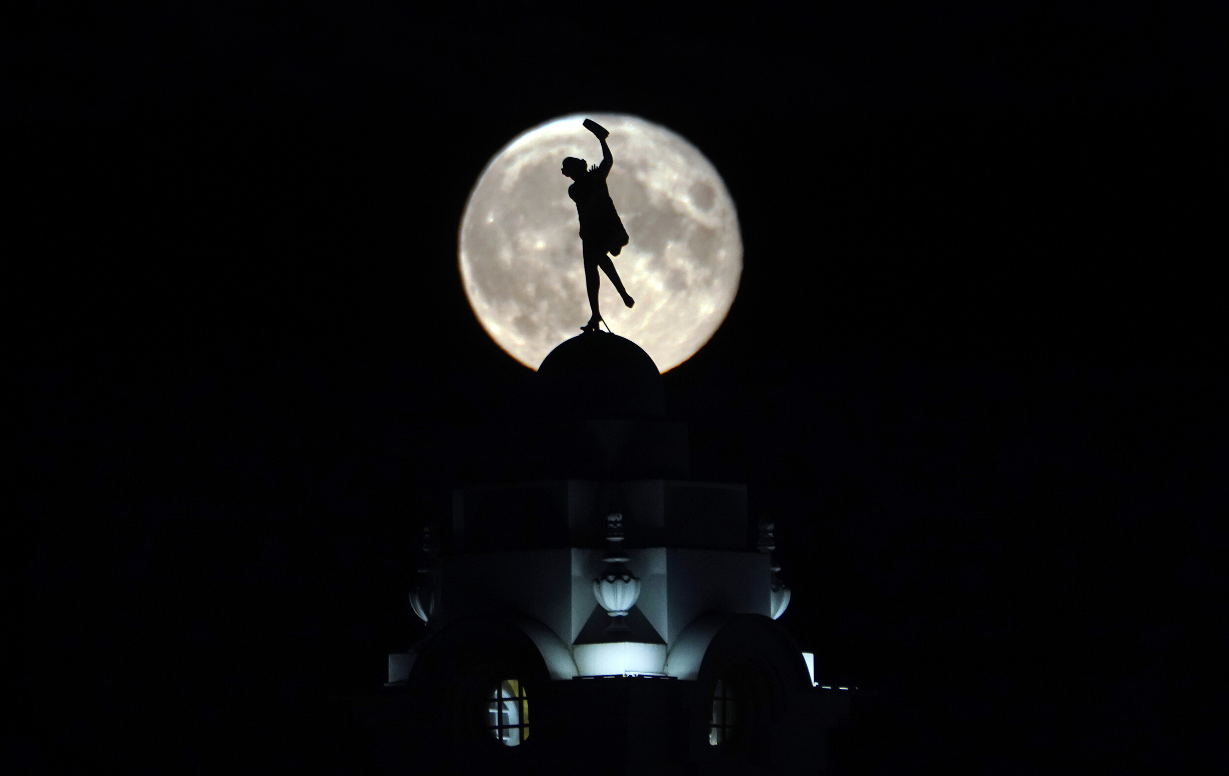 <i>Press Association/Sipa USA</i><br/>The full buck moon rises over a dancing lady on the Spanish City building in Whitley Bay