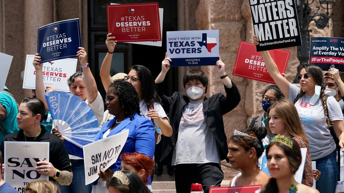 <i>Eric Gay/AP</i><br/>Demonstrators join a rally to protest proposed voting bills on the steps of the Texas Capitol.