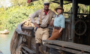 """Dwayne Johnson and Emily Blunt are pictured in Disney's latest ride-turned movie """"Jungle Cruise."""""""